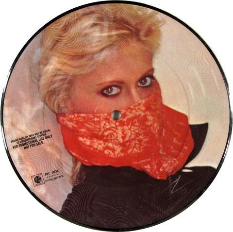 """Olivia Newton-John Vinyl 7"""" (Used)"""